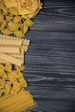 Pasta mix on wooden background Royalty Free Stock Photography