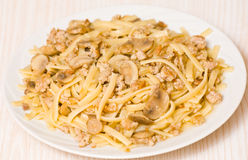 Pasta with mushroom and minced meat. On plate Royalty Free Stock Image