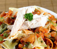 Pasta with mushroom sauce and fish Stock Photo