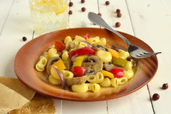 Pasta with mushrooms and bell peppers Stock Photos