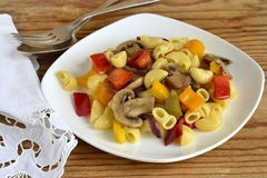 Pasta with mushrooms and bell peppers Stock Image