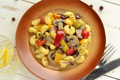 Pasta with mushrooms and bell peppers Stock Images