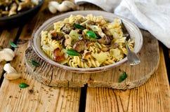 Pasta with mushrooms, cabbage Stock Photo