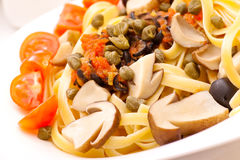 Pasta with mushrooms and capers closeup Royalty Free Stock Image
