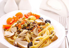 Pasta with mushrooms and capers Royalty Free Stock Image