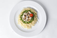 Pasta with mushrooms and cherry tomatoes, lined by a circle of g Stock Photos