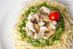 Pasta with mushrooms and cherry tomatoes, lined by Royalty Free Stock Photography