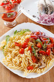 Pasta with mushrooms, cherry tomatoes and tomato sauce, italian food. Closeup Royalty Free Stock Image