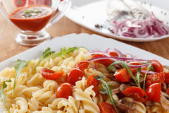 Pasta with mushrooms, cherry tomatoes and tomato sauce, italian food. Closeup Royalty Free Stock Photo