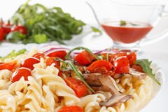 Pasta with mushrooms, cherry tomatoes and tomato sauce, italian food. Closeup Stock Images