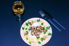 Pasta with mushrooms on a dark background royalty free stock image