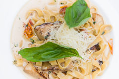 Pasta with mushrooms and parmesan. Cheese in a creamy sauce Stock Image