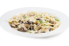 Pasta with mushrooms and Parmesan cheese. Pasta with mushrooms, Parmesan cheese and green onions Stock Photos