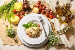 Pasta with mushrooms. Pasta penne with grilled mushrooms with Basil Royalty Free Stock Photography