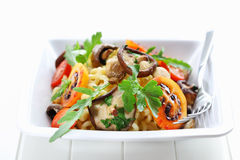 Pasta with mushrooms and tamarillos Stock Photography