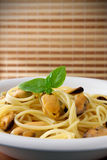 Pasta and mussels Stock Photos