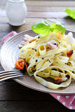 Pasta with mussels and  baby squid Stock Image