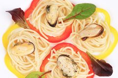 Pasta with mussels and basil. Stock Photos