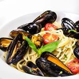 Pasta with mussels and basil for a tasty sea food Royalty Free Stock Photos