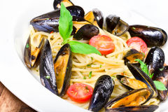 Pasta with mussels and basil for a tasty sea food meal macro. Seafood Pasta with mussels and basil for a tasty sea food meal macro stock photo