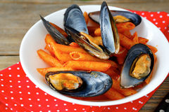 Pasta with mussels in a bowl on napkin Royalty Free Stock Photography