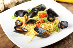 Pasta with mussels and cherry tomatoes Royalty Free Stock Photo