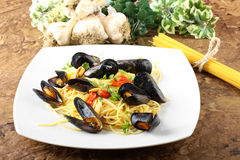 Pasta with mussels and cherry tomatoes Stock Images