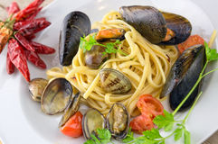 Pasta with mussels, clams and cherry tomatoes Stock Photos