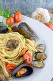 Pasta with mussels, clams and  fresh cherry tomatoes Royalty Free Stock Images