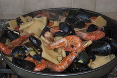 Pasta with mussels prawns and zucchini Stock Photo