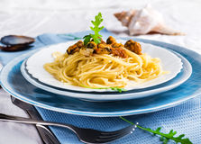 Pasta with mussels Stock Photos
