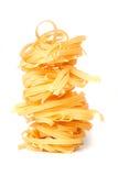 Pasta nest isolated on white. Tagliatelle pasta nest isolated on white background Royalty Free Stock Images