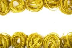 Pasta nest noodles. Raw tagliatelle close up. Pasta nest noodles Royalty Free Stock Image