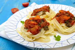 Pasta nest tagliatelle with bolognese sauce and vegetables Stock Photo