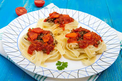 Pasta nest tagliatelle with bolognese sauce and vegetables Stock Photos