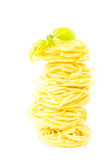 Pasta nests with basil Royalty Free Stock Photos