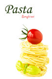 Pasta nests with cherry tomato and basil Royalty Free Stock Photo