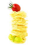 Pasta nests with cherry tomato and basil Stock Photography