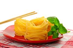 Pasta nests on a dish Stock Images