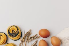 Pasta nests and ingredients. Top view of pasta nests and ingredients royalty free stock photography