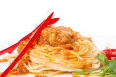 Pasta nests stuffed meatball in tomato sauce Stock Photos