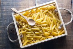 Pasta. No cook on wood background Stock Image