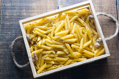 Pasta. No cook on wood background Stock Photo