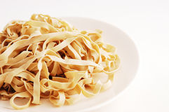 Pasta Noodle. Uncooked raw pasta / noodle. Space for copy text on the right Stock Photos