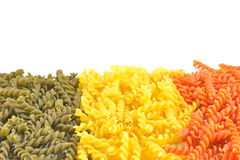 Pasta. Is a noodle made from an unleavened dough of a durum wheat flour mixed with water and formed into sheets or various shapes, then cooked and served in any Royalty Free Stock Photo