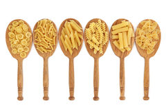 Pasta in Oak Spoons. Pasta food selection in oak wood spoons over white background Stock Photography