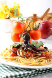 Pasta with octopus and tomato Stock Photography