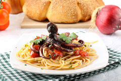 Pasta with octopus and tomato Stock Image