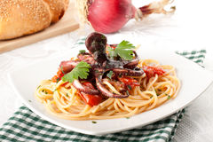 Pasta with octopus and tomato Royalty Free Stock Images