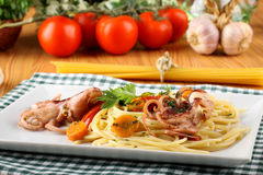 Pasta with octopus, tomatoes and carrots Royalty Free Stock Photos
